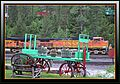This is a view i took while sat outside the Inn - Up on the hill behind the locomotive you can see a couple of Cabooses that are available for rent The Izaak Walton Inn is built next to a railroad helper station. The rail - panoramio.jpg