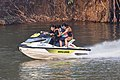 Three teenagers on a jetski running at full speed on the Mekong.jpg