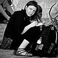 Tourist writing a postcard from Lisbon (29339082767).jpg