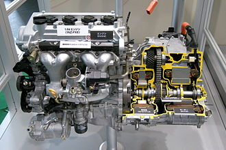 Hybrid Synergy Drive - Toyota 1NZ-FXE engine (left) with early HSD, sectioned and highlighted (right). Generation 1/Generation 2, chained, ICE-MG1-MG2 Power Split Device HSD is shown.