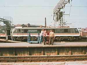 British Rail brand names - In 1989 with a British Rail Class 90 at the platform ends of Manchester Piccadilly under British Rail as part of InterCity.