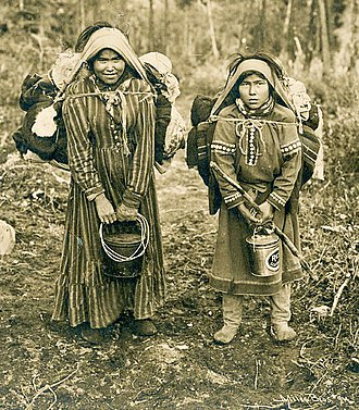 Ahtna - Chief Stickwan's two daughters holding buckets and carrying burdens on backs with trumplines, Klutina-Copper Center band of Lower Ahtna, 1903