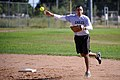 U.S. Air Force Col. William J. Liquori Jr., commander of the 50th Space Wing, throws a ball completing a double play during the fourth inning of a softball game between chiefs and colonels assigned to Schriever 130920-F-JY173-001.jpg