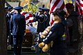 U.S. Airmen with the Hill Air Force Base Honor Guard fold a U.S. flag over the casket of a fallen Airman during a funeral service Oct. 26, 2013, near Ogden, Utah 131026-F-SP601-003.jpg
