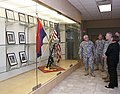 U.S. Army Gen. Frank J. Grass, center, the chief of the National Guard Bureau, reflects on the portraits of fallen Soldiers with the 45th Infantry Brigade Combat Team during a tour of the Norman Armed Forces 130528-Z-VF620-4474.jpg