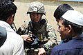 U.S. Army Staff Sgt. Jason Abigania, center, with the Kunar Provincial Reconstruction Team civil affairs section, speaks with residents at a school in the Narang district, Kunar province, Afghanistan, May 26 120526-F-NG741-187.jpg