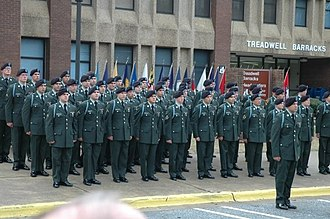 "Infantry blue cord - Newly qualified infantrymen receive their infantry blue cords at a ""Turning Blue"" ceremony in 2009, following 16 weeks of One Station Unit Training (OSUT), the day before graduation in front of their barracks at Fort Benning."