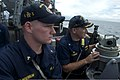 U.S. Navy Cmdr. Chase Sargeant, right, the commanding officer of the guided missile destroyer USS John S. McCain (DDG 56), shows a U.S. Naval Academy midshipman how to take bearings during an exercise with 140628-N-UN259-063.jpg