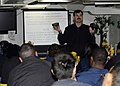 U.S. Navy Damage Control Assistant Chief Warrant Officer Terry Druen explains functions of a C-2 canister used for MCU-2P gas mask, during a chemical, biological and radiological training aboard the amphibious 110320-N-TI311-053.jpg