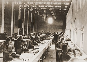English: Prisoners at forced labor building ai...