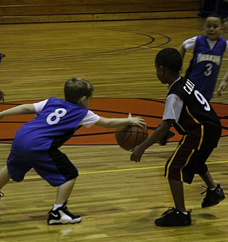 A young defender (left) steals the basketball from an opposing ballhandler USMC-110127-M-5506C-036 (cropped).jpg