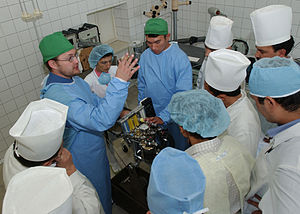 Mobile army surgical hospital (US) - U.S. Army soldiers and Dilmurod local national interpreter train local Uzbek anesthesia providers on the 885 Mobile Anesthesia Machine at the Fergana Emergency Center in support of Operation Provide Hope.