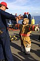 US Navy 021123-N-4729H-238 A youngster tries on Fire Fighting Ensemble.jpg