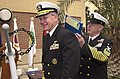 US Navy 030119-N-4943L-004 Adm. Vern Clark, Chief of Naval Operations (CNO), assists U.S. Naval Medical Research Unit Three's (NAMRU-3) Master Chief Joe Diaz with signing his reenlistment contract.jpg