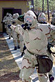 US Navy 030212-N-1261P-001 A group of Seabees go through Chemical Biological and Radiological (CBR) personnel decontamination training.jpg