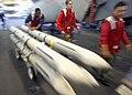 US Navy 030312-N-3235P-501 The Mediterranean Sea (Mar. 12, 2003) - Aviation Ordnancemen assigned to weapons department, transfer radar-guided AIM-7 Sparrow air-to-air missiles across the ship's hangar bay.jpg