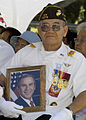 US Navy 030625-N-5024R-007 A member of the Veterans of Foreign Wars (VFW) Post 10276 demonstrates his patriotism for the United States with a photo of President George W. Bush.jpg