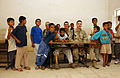 US Navy 031014-N-3236B-009 A Sailor and Marine assigned to Expeditionary Strike Group One (ESG-1) sit with students during a site survey of a school house damaged and looted during Operation Iraqi Freedom.jpg