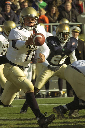 Quarterback - Navy quarterback Craig Candeto pitches the ball while running an option-based offense.