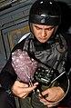 US Navy 031113-N-4768W-044 Sonar Technician 3rd Class Jon Kristoffersen, from Tacoma, Wash., inspects an explosive charge.jpg