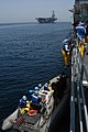 US Navy 040421-N-6433N-023 Crewmembers assigned to the guided missile cruiser USS Vella Gulf (CG 72) load passengers into a Rigid Hull Inflatable Boat (RHIB).jpg