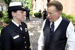 US Navy 040510-N-5321R-147 Lt. Eileen D'Andrea, left, and acclaimed actor Martin Sheen discuss the set-up of a scene filmed at the historic St. Anne's Church.jpg