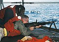 US Navy 040701-N-6293B-008 Torpedoman's Mate 3rd Class David Avery of Houston, Texas, assists personnel during an M-60 machine-gun training exercise aboard USS Enterprise CVN 65.jpg