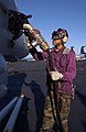 US Navy 041114-N-2143T-016 Aviation Boatswain's Mate Airman Edward Abrams of Seattle, Wash., fuels an F-A-18 Hornet aboard the aircraft carrier USS Nimitz (CVN 68).jpg