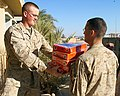 US Navy 050108-M-2583M-043 Marines assigned to the 4th Civil Affairs Group (CAG) and U.S. Army Soldiers assigned to the 507th Medical Air Ambulance Company at Al Asad Air Base, move boxes of school supplies, beanie babies, book.jpg