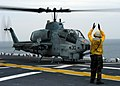 US Navy 050112-N-5313A-022 Aviation Boatswain's Mate 3rd class Jabin Rose from Palm Coast, Fla., directs an AH-1W Cobra Helicopter on the flight deck of the amphibious assault ship USS Kearsarge (LHD 3).jpg