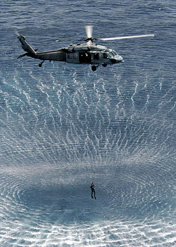 US Navy 050419-N-5313A-414 Search and Rescue (SAR) swimmers attached to the Kearsarge Expeditionary Strike Group conduct search and rescue training during routine helicopter operations.jpg