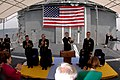 US Navy 050422-N-9389D-131 Commander, Carrier Strike Group Five, Rear Adm. Jamie Kelly and guests applaud Capt. Jonathan E. Will, outgoing commanding officer of guided missile cruiser USS Chancellorsville (CG 62).jpg