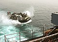 US Navy 050612-N-3557N-102 A Landing Craft Air Cushion (LCAC) assigned to Assault Craft Unit Four (ACU-4) maneuvers into position to enter the well deck aboard the amphibious assault ship USS Kearsarge (LHD 3).jpg