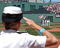 US Navy 050703-N-3286A-001 USS Bataan (LHD 5) Commanding Officer, Capt. Nora W. Tyson salutes the Bataan Color Guard during the playing of the National Anthem.jpg