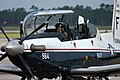US Navy 050828-N-2744D-029 A pilot assigned to Training Air Wing Six, prepares his T-6A Texan II turboprop trainer for departure on board Naval Air Station Pensacola, Fla., where evacuations are underway for Hurricane Katrina.jpg