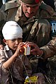 US Navy 051017-N-8796S-223 An injured Pakistani boy is given a box of juice and some food as well as medical attention.jpg