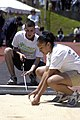 US Navy 060523-N-5608F-004 Cryptologic Technician Administration 2nd Class Regina Chandra, right, assigned to the Pentagon and a Marine Corps volunteer take a tape measurement for the running long jump competition during the 20.jpg