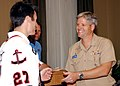 US Navy 061030-N-0916O-072 Capt. Loyd Pyle, commanding officer of Naval Station Norfolk, hands Brandon Bochenski, of the American Hockey League's Norfolk Admirals, a command coin.jpg