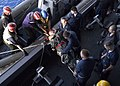 US Navy 061104-N-7375S-061 U.S. Navy Sailors unload an injured passenger from the cruise liner Celebrity Century onto the multipurpose amphibious assault ship USS Wasp (LHD 1).jpg