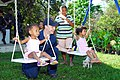 US Navy 070225-N-4124C-008 Seaman Justin M. Armstrong, assigned amphibious transport dock USS Juneau (LPD 10), plays with young children from the Aeta Resettlement in Sitio Gala district as part of a community service project.jpg
