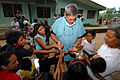 US Navy 070720-N-8704K-144 U.S. National Guard Lt. Col. Richard Tate, attached to the Military Sealift Command hospital ship USNS Comfort (T-AH 20), hands out toothbrushes to children at the 15 de Julio Health Care Center.jpg