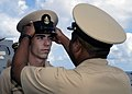 US Navy 070921-N-4649C-078 Chief Fire Controlman Shawn Bell receives his combination cover from Chief Intelligence Specialist Kenyan Thompson during a chief petty officer pinning ceremony aboard Arleigh Burke-class guided-missi.jpg