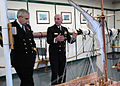 US Navy 071106-N-9793B-001 Senior Chief Hospital Corpsman Don Abele discusses a training model of the rigging aboard USS Constitution with Lt. Cmdr. John Scivier, commanding officer of HMS Victory.jpg