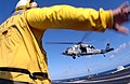 US Navy 080205-N-2838C-003 An Aviation Boatswain's Mate (Handler) aboard the Nimitz-class aircraft carrier USS Theodore Roosevelt (CVN-71) directs an MH-60S Seahawk.jpg