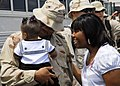 US Navy 080804-N-3857R-006 A Seabee assigned to Naval Mobile Construction Battalion (NMCB) 74 greets his family.jpg