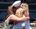 US Navy 080807-N-7029R-065 Aerographer's Mate 1st Class Jeffrey Jackson embraces his wife and daughter after departing the aircraft carrier USS Kitty Hawk (CV 63) at Naval Air Station North Island.jpg