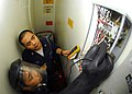 US Navy 080925-N-5148B-013 Electrician's Mate 2nd Class Roel Villansin and Electrician's Mate 2nd Class Rem Cepeda trouble shoot ventilation in an ammo storage cargo hold.jpg