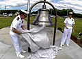 US Navy 090501-N-0995C-031 Lt. Cmdr. Jay Gulley, officer-in-charge of U.S. Naval Ammunition Depot, Oahu, Hawaii unveils a bell recovered from USS Hornet (CV 8) that was dedicated to the command for its 75th anniversary.jpg