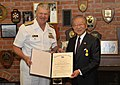 US Navy 090705-N-8273J-047 Chief of Naval Operations (CNO) Adm. Gary Roughead presents Mr. Yoshiro Ito with the Distinguished Public Service Award.jpg