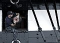 US Navy 090820-N-0167W-039 Machinist's Mate 1st Class Chad Craycraft, a chief petty officer select temporarily assigned to USS Constitution, removes the tampion from a 24-pound long gun aboard Constitution.jpg